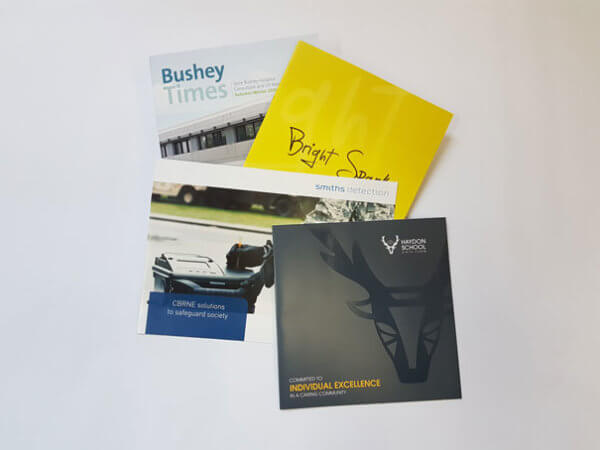 Four printed brochures from Colprint's leaflet service